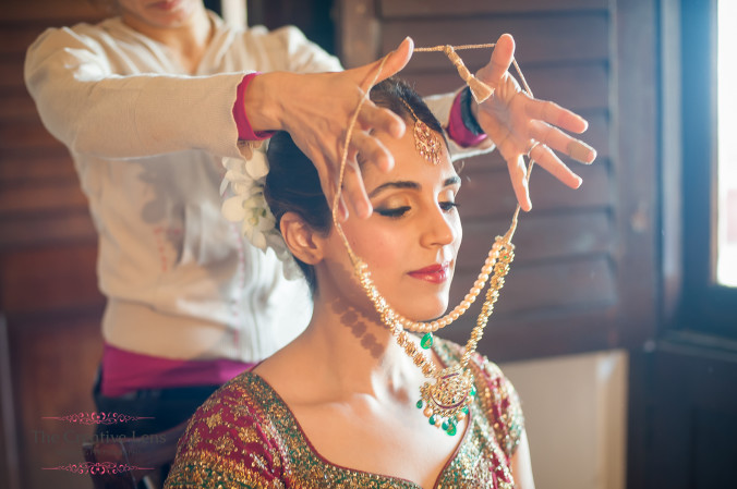 a bride getting ready and putting on her bridal jewelry